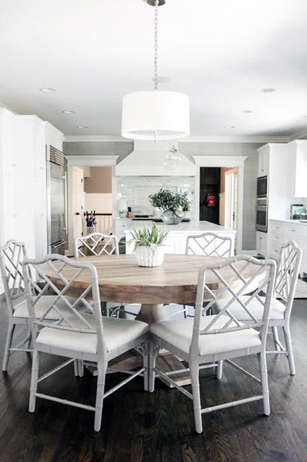 round dining table and white chairs