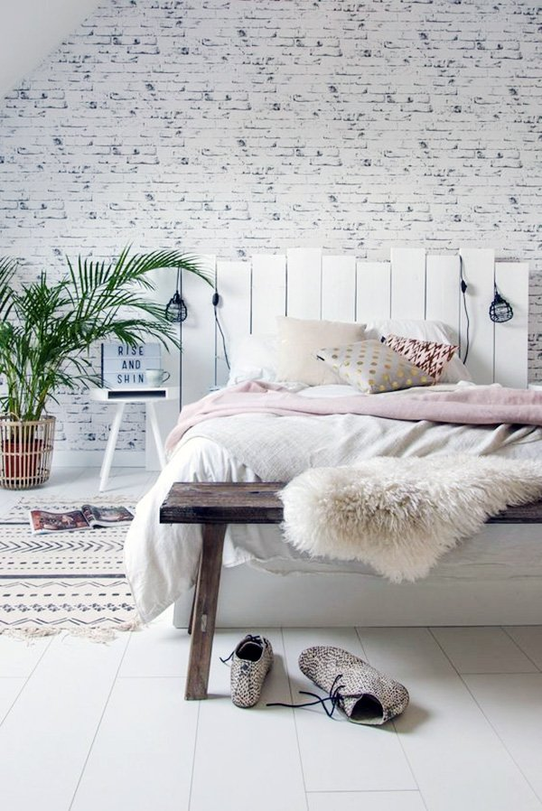stylish and cosy bedroom design with chic white headboard