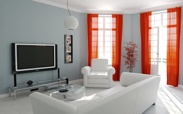 stylish living room design with all white coach and red curtains