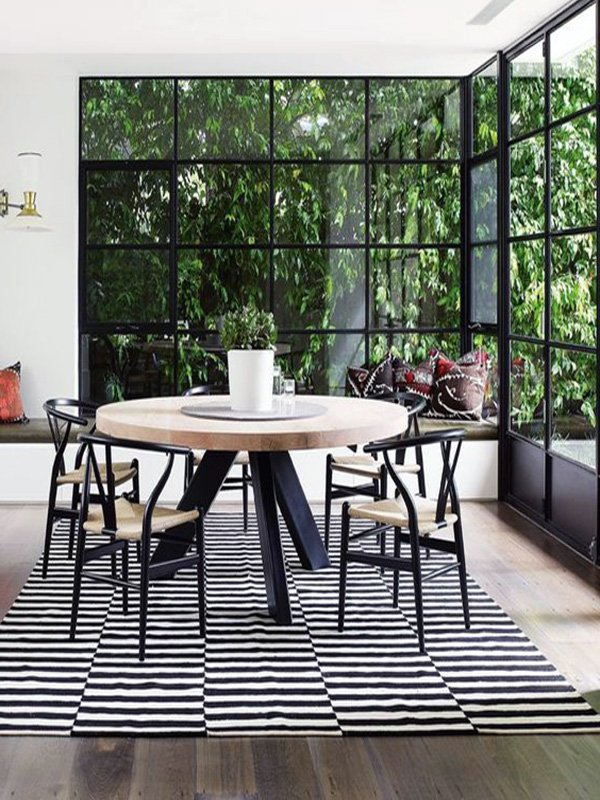 stylish round wooden dining table design idea