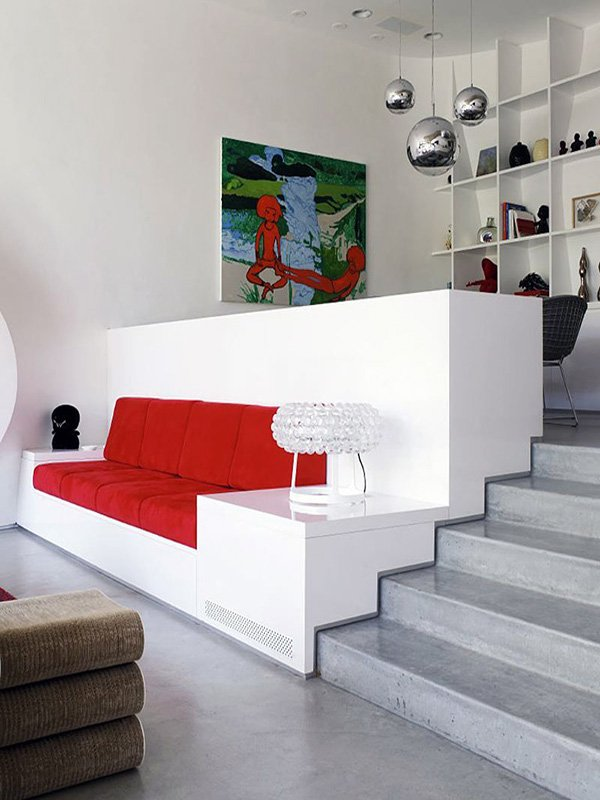 white living room design with red stylish coach