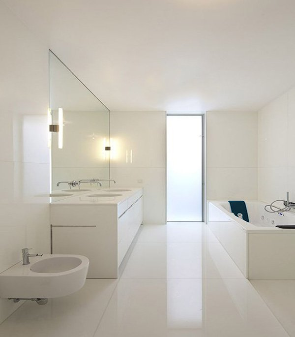 all-white minimalist bathroom