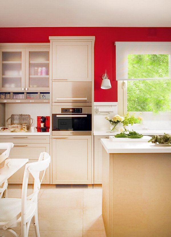 bright stylish kitchen design with red wall